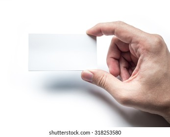 Closeup of hand holding business card on the white wall, Mockup