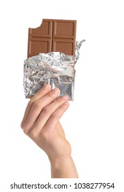 Close-up Of Hand Holding Chocolate Over White Background