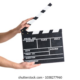 Close-up Of Hand Holding Clapper Board Over White Background