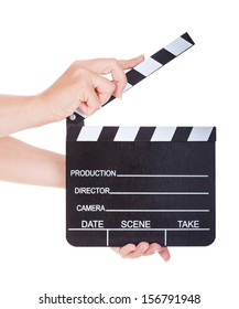 Close-up Of Hand Holding Clapperboard On White Background