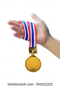 Close-up Of hand holding a gold medal with neck strap.