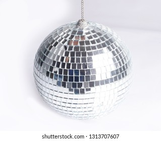 closeup .hand holding a mirror ball.isolated on gray background