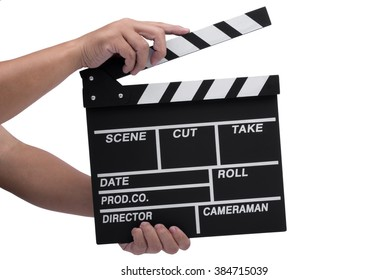 Close-up of hand holding movie clapperboard isolated on white background.