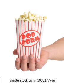 Close-up Of Hand Holding Popcorn Over White Background