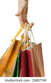 Close-up of a hand holding shopping bags isolated on white