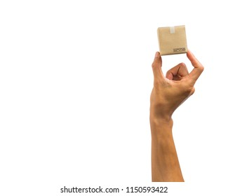 Close-up of hand holding small paper carton isolated on white background. Clipping path of hand holding small box against white background.