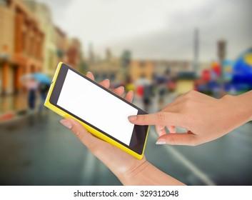 Closeup of hand holding smart phone on street