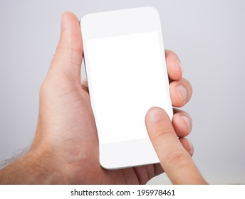 Closeup of hand holding smartphone with blank screen
