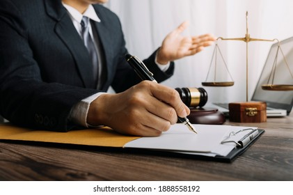 Close-up hand holding a wooden gavel of lawyer on tabel in courtroom. justice and law ,attorney, court judge, concept.