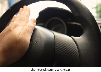 Closeup Of Hand Honking Car Horn