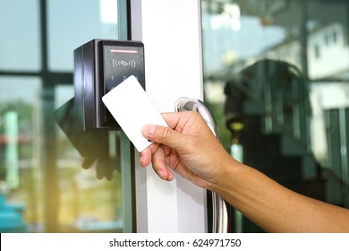 Close-up hand inserting keycard to lock and unlock door - Door access control keypad with keycard reader