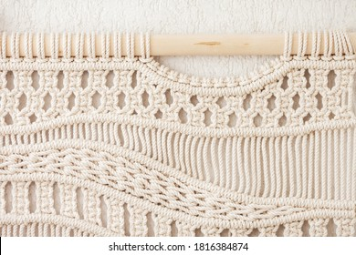 Close-up  hand made macrame texture pattern. ECO friendly modern knitting. Natural decoration concept in the interior.  Flat lay.  Handmade macrame 100% cotton. Female hobby.