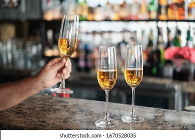 closeup hand of man holding glass of champagne