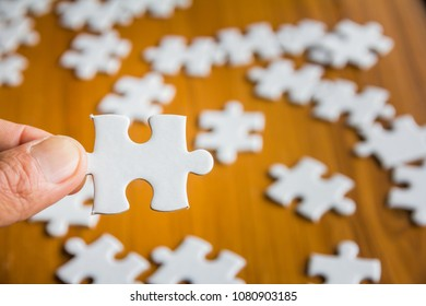 Closeup hand of man Holding parts jigsaw puzzle with, �ื��หลั��������ะ�ม�, Business solutions, success and strategy concept