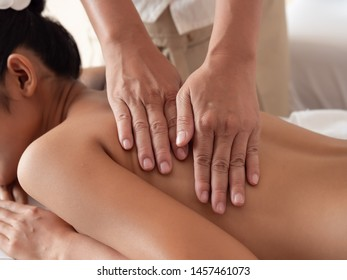 Close-up of hand masseuse in the Spa Salon. Thai massage for health.