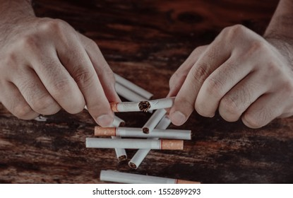 Closeup of hand men who are holding cigarettes and deduct destroy cigarettes. concept of smoking cessation