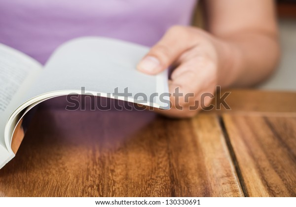 Closeup hand open book for reading concept background