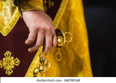 Closeup of the hand of an orthodox priest holding a censer