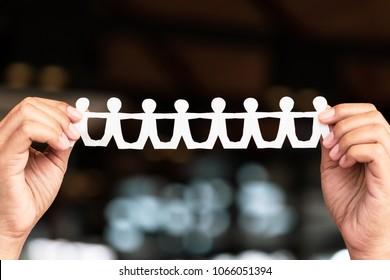 Closeup hand show a paper human chain