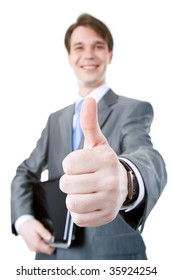 Close-up of businessman?s hand showing thumb up on the background of male with laptop