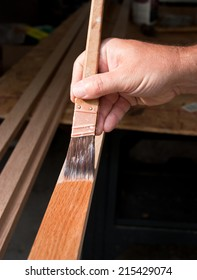 Closeup of a hand staining wood