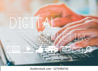 Closeup hand using Laptop PC with Digital Marketing concept. Online media icon, Mobile Application, social network, video, email, SEO and Advertise