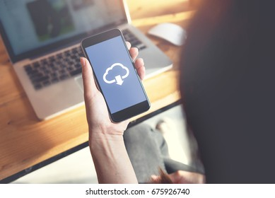 Closeup hand of woman with Cloud download on mobile smartphone.
