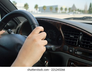 closeup of the hand of a woman driving