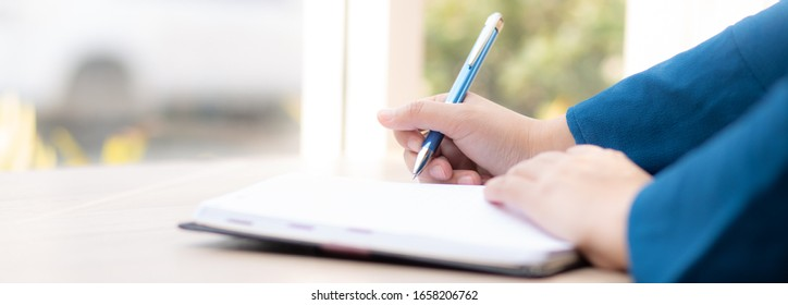 Closeup hand woman writer thinking idea and writing on notebook or diary with happy, lifestyle of asian girl is student, female planning working, education and business, concept.