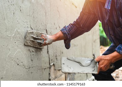 closeup hand of worker are plastering on wall