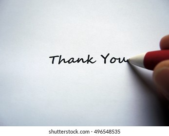 Closeup of a hand writing message Thank You