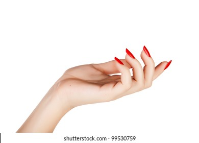 closeup of hand of a young woman with long red manicure on nails against white background