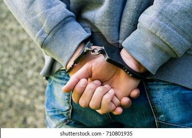 close-up handcuffed hands of a businessman. Concept of crime and detention