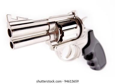 Closeup of handgun on plain background