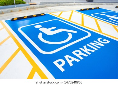 closeup handicap parking sign painted on the floor of parking area. handicap parking, disabled parking permit.