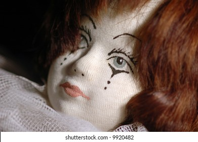 close-up of a handmade doll with tears in her eyes