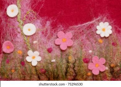 Closeup of handmade felt bag decorated with flowers.