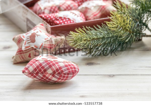 Closeup of handmade heart figurine over wooden table