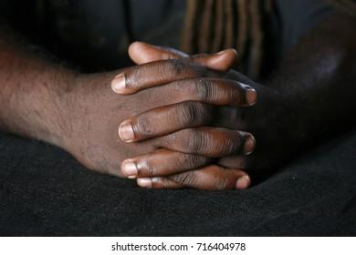Closeup of hands of African American man
