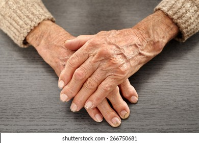 Closeup of hands with artritis of an old farmer man