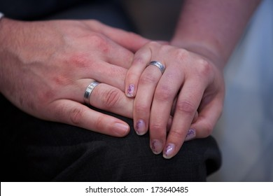 Close-up of the hands of a bride and broom holding each other