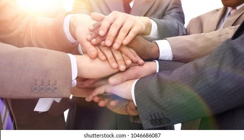 closeup - hands of businessmen stacked together
