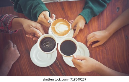 Closeup of hands with coffee cups in a cafe.Stylish Vintage