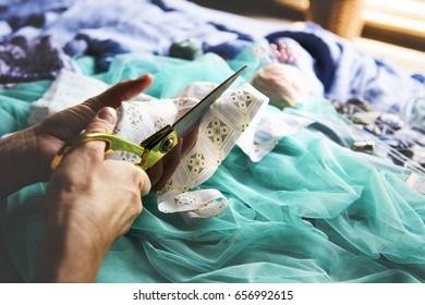 Closeup of hands cutting fabric handicraft handmade
