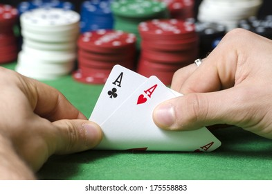 Closeup of hands with double ace