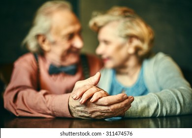 Close-up of hands of elderly couple