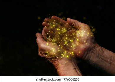 closeup hands of elderly man begging for help. concept for poverty or hunger or seeking for light in the dark
