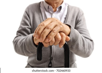 Close-up of hands of an elderly man on a walking cane isolated on white background
