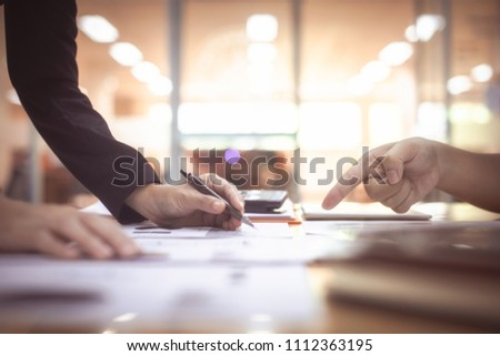 Close-up hands of Engineer working Drawing Plan On Blueprint with architect equipment at the table, team work, Construction concept. Engineering tools.