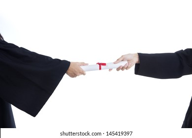 Close-up of hands giving graduation certificate on white background